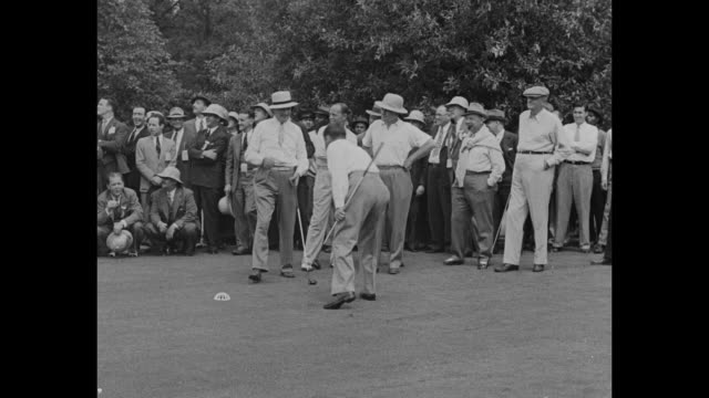 washington dc superimposed over group shot of attorney john e mcclure professional golfer bobby jones us attorney general homer stille cummings and... - golf links stock videos and b-roll footage