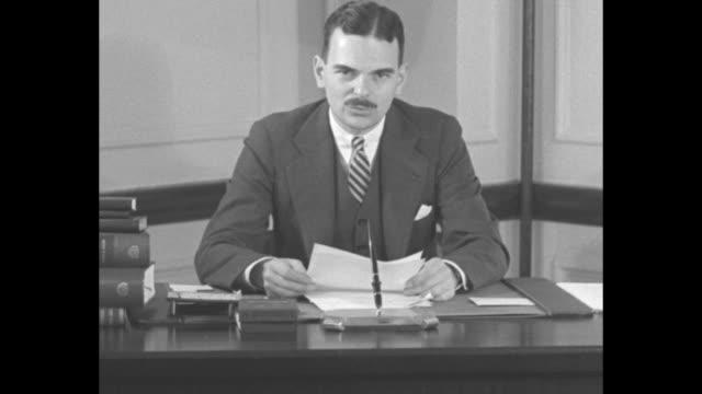 """watch dewey"" / title card: ""smash rackets"" / new york county special prosecutor thomas dewey sitting art desk speaking to camera / group of... - bonding stock videos & royalty-free footage"