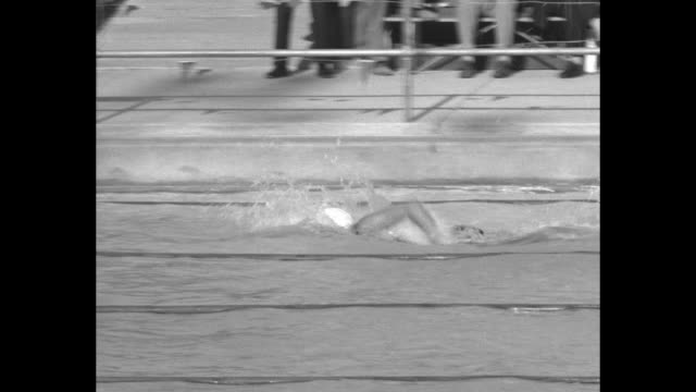 watch helene madison's perfect form which brought her olympic victories / ms us swimmer helene madison swims freestyle / pan crowds cheer in stands /... - 1932 stock videos & royalty-free footage