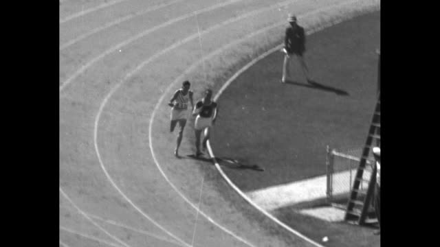 """watch lehtinen block hill of u.s. on straightaway"" / glancing over his shoulder runner in dark shirt lauri lehtinen keeps ahead of runner ralph hill... - sideways glance stock videos & royalty-free footage"