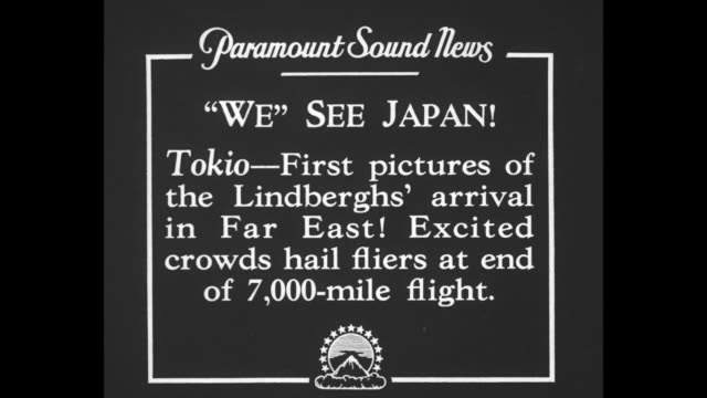'we' see japan tokio first pictures of the lindberghs' arrival in far east excited crowds hail fliers at end of 7000mile flight / charles lindbergh... - carrying stock videos & royalty-free footage