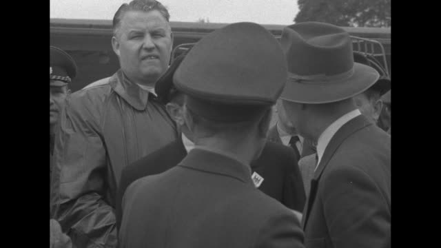 west germany sends russian criminals home superimposed over officials standing at the border / a united states military policeman talks to man in... - military policeman stock videos and b-roll footage