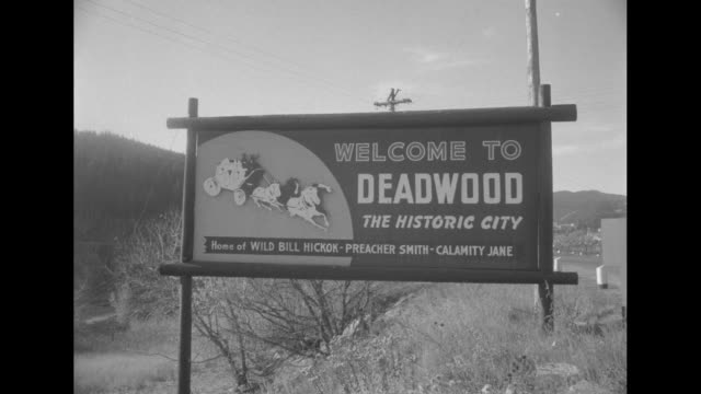 Western Style Premiere for 'Calamity Jane' / sign on hill 'Welcome to Deadwood the Historic City home of Wild Bill Hickok Preacher Smith Calamity...