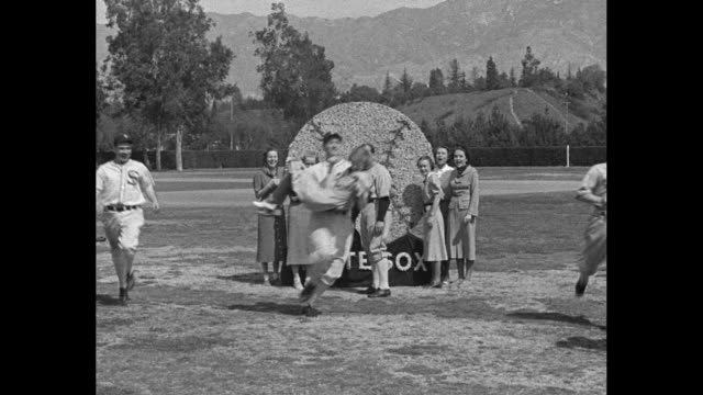 White Sox Get Set For 1937 Season / title Pasadena Calif superimposed over players running around large baseball made of flowers / women standing by...