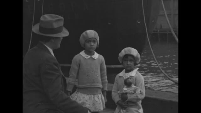 vídeos de stock e filmes b-roll de will you mr gandhi new york 'come to america' mariam and lilabati ghose daughters of us hindu leader sail to invite mahatma here / sisters lilabati... - 1931