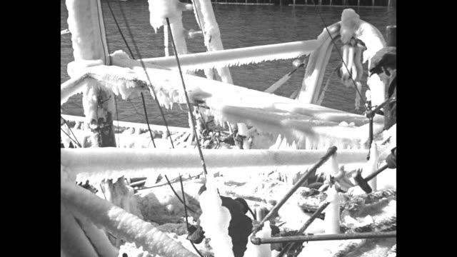 winter sheathes fishing trawlers in coat of ice crews have lots of work clearing rigging of vessels after they arrive in boston / trawler moving... - mallet hand tool stock videos and b-roll footage