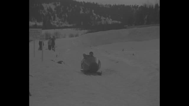 """vídeos de stock e filmes b-roll de """"winter sports hit peak for season lake placid club, n.y. - bobsledders open first track in america with mile a minute run"""" / vs bobsleds over ridge... - bobsleighing"""