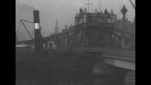 "title card, with ""eve's film review 648"": ""bridge contrasts in copenhagen"" / title card: ""like london, copenhagen. with its many waterways has a... - swing bridge stock videos & royalty-free footage"
