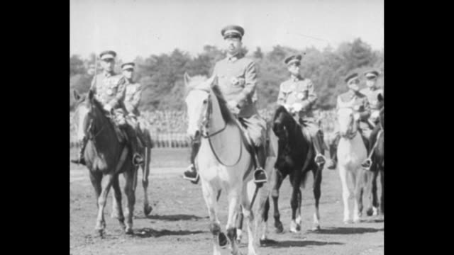 title card with japanese calligraphy / vs hundreds of soldiers with rifles and bayonets / emperor hirohito on white horse with aides / man with... - bayonet stock videos and b-roll footage
