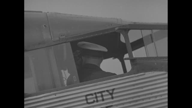 'with lindy as pilot' /¾charles lindbergh in cockpit of plane 'city of los angeles' / airplane begins to move / signs on craft tat transcontinental... - charles lindbergh stock videos & royalty-free footage