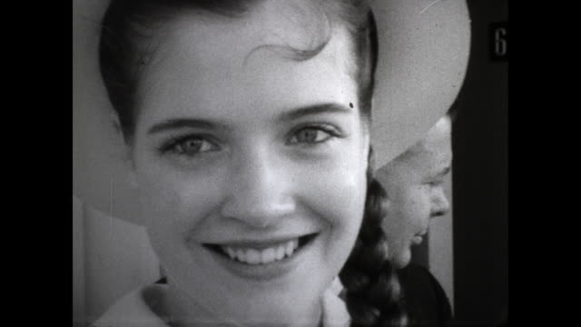 """title card with the words """"domestic news miss teenage american finals! newsfilm, usa""""; still shot of close up of young girl smiling at the camera - contestant stock-videos und b-roll-filmmaterial"""