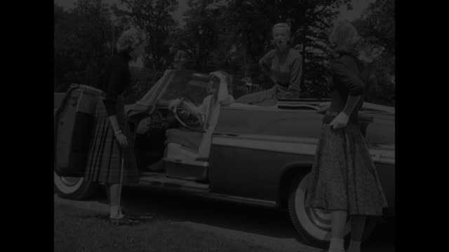 WOOL FASHIONS DO ITYOURSELF FOR SEPARATES superimposed over pan shot of Chrysler convertible pulling up to curb and stopping / two female models...