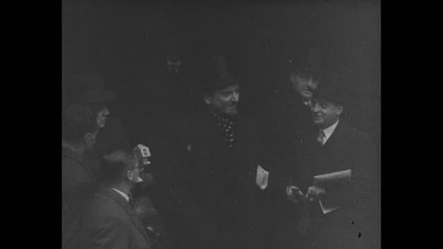 """""""world naval conference meeting in london"""" / japanese delegation pose for photograph wearing top hats and overcoats, turn to enter building / other... - top hat stock videos & royalty-free footage"""