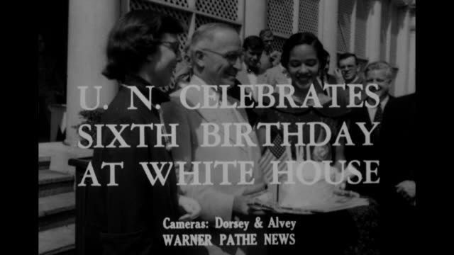 """world news"" / title card un celebrates sixth birthday at white house superimposed over smiling president truman holding birthday cake standing... - silver platter stock videos and b-roll footage"