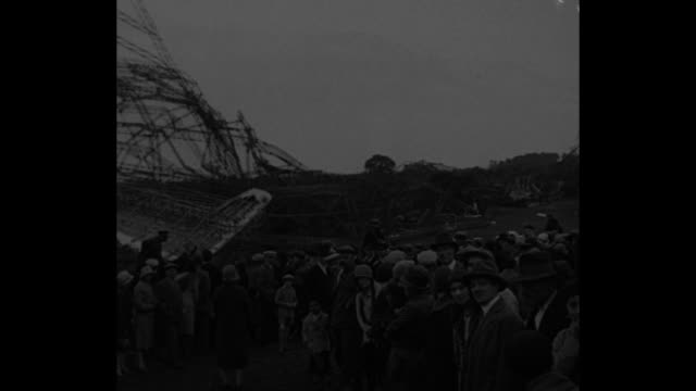 vidéos et rushes de world was shocked with britain's proud sky monarch exploded on cruise to india just a year ago / file crowds gather at burnt wreckage of britain's... - royal air force