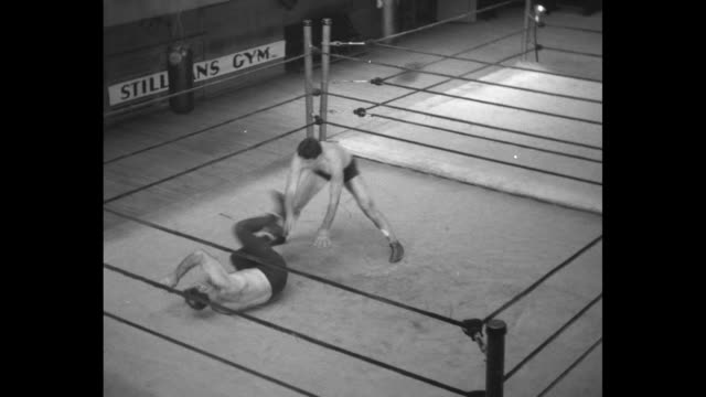 wrestling sensation reveals holds used to toss opponents sammy stein shows you just how to get the grips that spell victory in mat bouts / stein and... - narrating stock videos & royalty-free footage