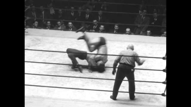 """""""wrestling stars smack the canvas in savage bout - ray steele and sandor szabo give each other plenty of punishment in new york arena"""" / vs elevated... - tights stock videos & royalty-free footage"""