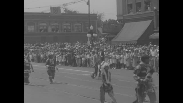 """wyandotte county's 75th birthday"" / parade with police on motorcycles, car and indians, some on horseback moving down street, crowds line sides /... - showing stock videos & royalty-free footage"