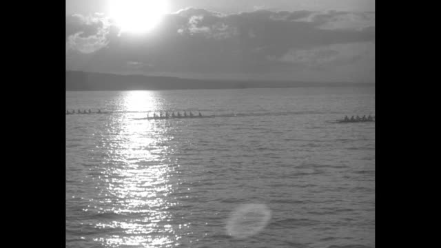 """""""yale and cornell stage most exciting regatta of year - college oarsmen turn lake cayuga race for carnegie cup into fight to finish"""" / vs rowing... - cayuga stock videos & royalty-free footage"""