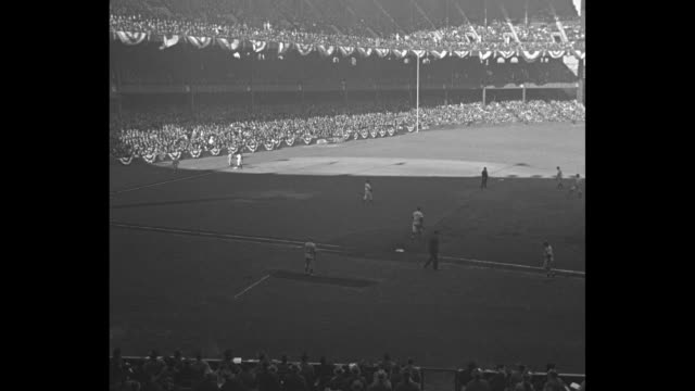 yanks take third 52 / ws filled stands at new york's yankee stadium where the ny yankees play the chicago cubs in the 1938 world series / new york... - frivarv bildbanksvideor och videomaterial från bakom kulisserna