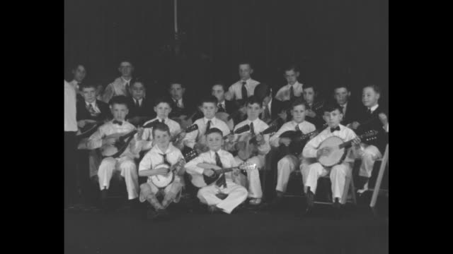 young banjo band plays old favorites brookline mass boys ranging from 7 to 12 years of age strum popular tunes of bygone days / vs 20 boys sitting on... - banjo stock videos & royalty-free footage