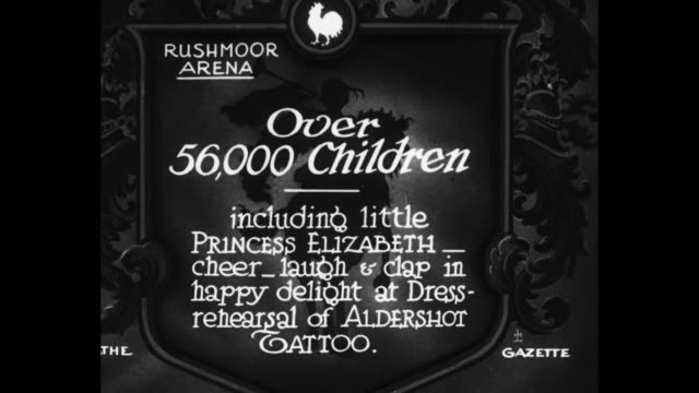 """young britain hails king's men at aldershot : 56,000 children, including little princess elizabeth, delighted by the stirring military spectacle"" /... - piccolo video stock e b–roll"