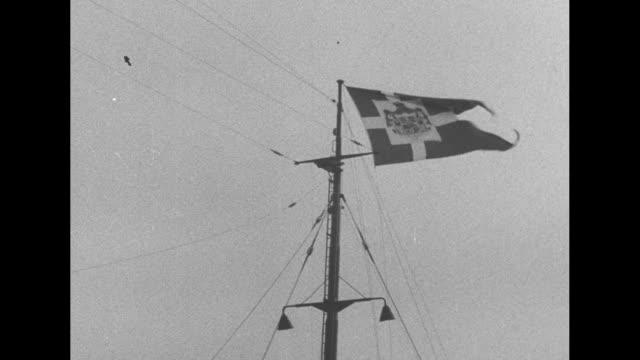 danish royal state visit / ship carrying frederick ix of denmark steams into port at dover / shot of danish flag flying atop mast on ship / frederick... - fluggastbrücke stock-videos und b-roll-filmmaterial
