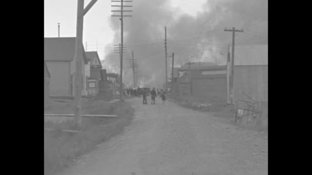 fire destroys nome / paramount news presents first pictures from alaska showing famous 'gold city' burning to the ground a vivid portrayal of... - american eskimo dog stock videos & royalty-free footage