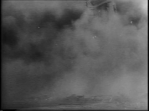 vídeos de stock, filmes e b-roll de title cards 'french front' and 'on to germany' / burning ruined buildings boy walking towards buildings away from camera / canadian soldiers walk... - paramount building