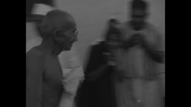 "stockvideo's en b-roll-footage met ""intimate glimpses of gandhi, india's man of mystery"" and ""editor's note: no man in centuries has stirred india's teeming millions as much as this... - mahatma gandhi"