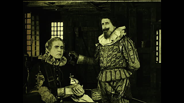 title cards introducing two english officials in charge of the colony, 17th century,; two men smoking and discussing london and the future of the... - 17th century stock videos & royalty-free footage
