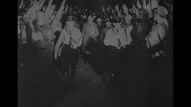 part 1 the rise of the nsdap 19211933 alfred rosenberg describes the early nazi struggle for power / nazi flag flying in the breeze / joseph goebbels... - ナチズム点の映像素材/bロール