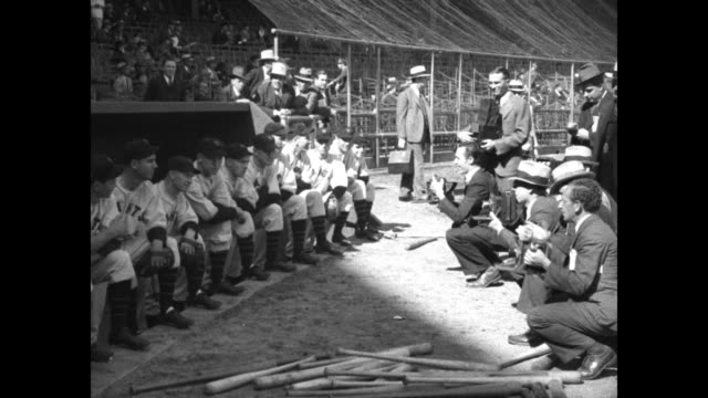 special and giants win world series opener / elevated view of the polo grounds decorated with bunting with a crowd of tens of thousands / new york... - baseballmannschaft stock-videos und b-roll-filmmaterial