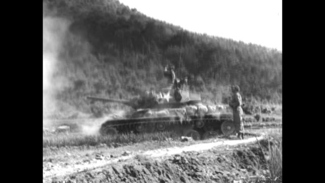 'The Red Cross Report narrated by Quentin Reynolds' / VS heavy artillery tanks firing and resulting explosions and fires / VS wounded US soldiers on...
