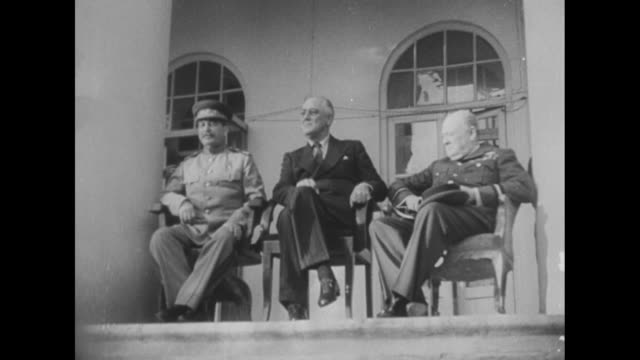 "title ""casablanca, 1943"" superimposed over franklin roosevelt and winston churchill sitting next to one another at casablanca conference as aides... - winston churchill prime minister stock videos & royalty-free footage"