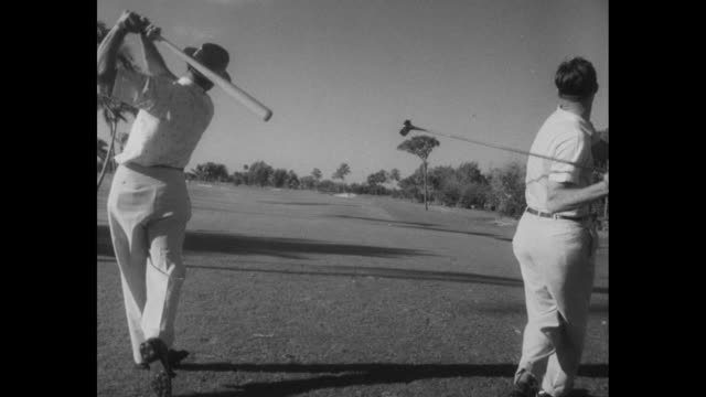 cerebral palsy fund winner in fla golf superimposed over golfer sam snead teeing off on golf course with palm trees in background / babe zaharias... - sun visor stock videos and b-roll footage