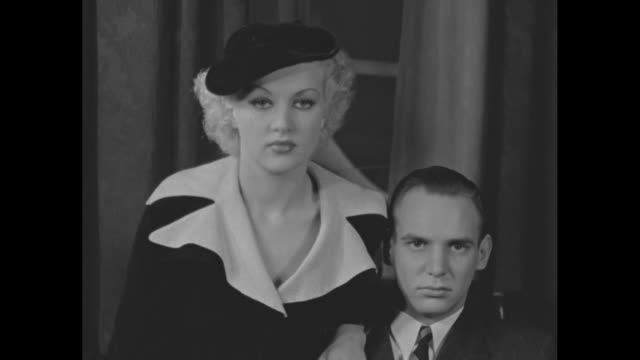 "vídeos de stock, filmes e b-roll de ""chicago, ill"" superimposed over l-r betty grable, jackie coogan and reporter / coogan / group w reporter asking about event / coogan / grable and... - chicago 'l'"