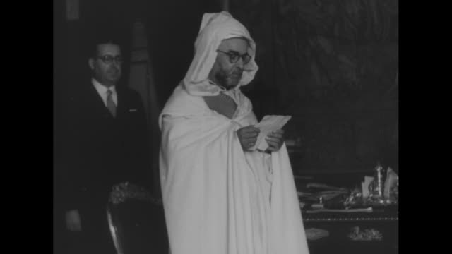 chiefs thank franco for morocco aid superimposed over franco talking / men in white robes stand around semicircle grand vizer muhammad al muqri reads... - semi circle stock videos & royalty-free footage