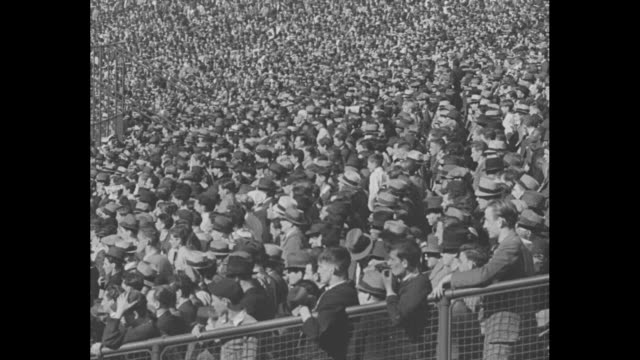 Cincinnati superimposed over crowd at CincinnatiÕs Crosley Field / 4/20/37 Dizzy Dean pitches for St Louis Cardinals as they play the Cincinnati Reds...