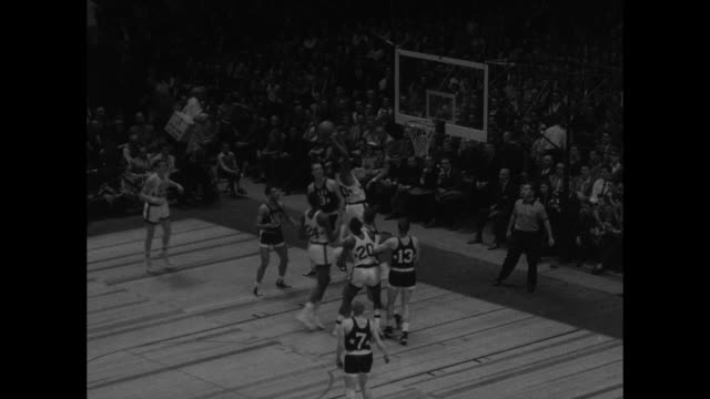 college allstars west cagers rout east superimposed over jump ball to begin basketball game in madison square garden / various action shots of game... - jump ball stock videos and b-roll footage