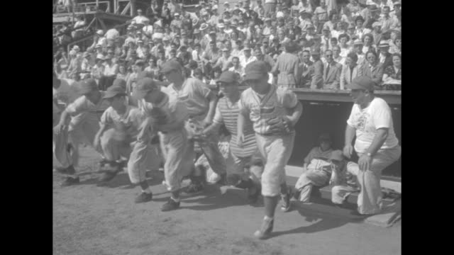 conn vs texas little league world series superimposed over little league players posing for photo / rows of little league team members walking onto... - little league stock videos and b-roll footage