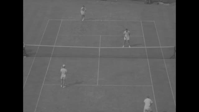 """""""davis cup thriller!"""" superimposed over action from tennis game / several action shots of game, australia's john bromwich and billy sidwell in near... - davis cup stock-videos und b-roll-filmmaterial"""