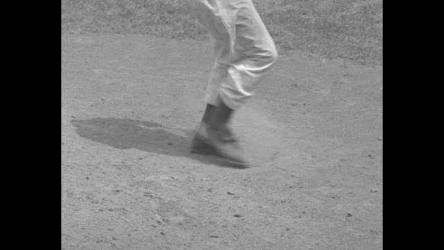 vídeos y material grabado en eventos de stock de don newcombe talk of the baseball world superimposed over newcombe standing on pitching mound during game preparing to throw pitch / slow motion shot... - base home