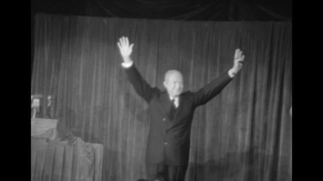 vídeos de stock, filmes e b-roll de title eisenhower superimposed over republican candidate dwight d eisenhower standing at podium speaking in panpacific hall in los angeles ca /... - dwight eisenhower