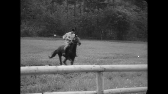 òequestrian olympicsó superimposed over horse and rider jumping a fence into water / elizabeth ii king gustaf vi adolf of sweden followed by princess... - princess margaret 1950 stock videos and b-roll footage