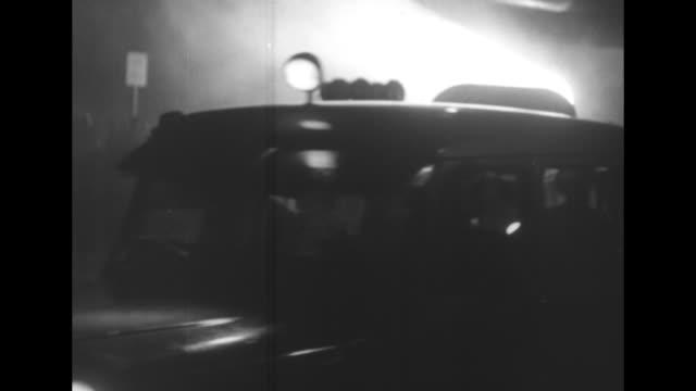 "vidéos et rushes de title ""escape seat fires pilot through roof"" superimposed over ejector seat headed into net / hoisted seat being lowered into cockpit, men guiding it... - phare de véhicule"
