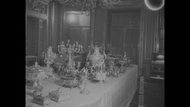 """""""farouk's treasures go--in 'auction of the century'"""" superimposed over table of auction items / exterior koubbeh palace / egyptian president and... - electric lamp stock videos & royalty-free footage"""