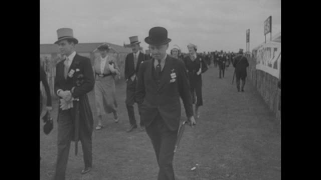 First Pictures MidDay Sun Wins Derby / race is nicknamed the Coronation Derby / people arriving / men in formal attire morning coats and top hats /...