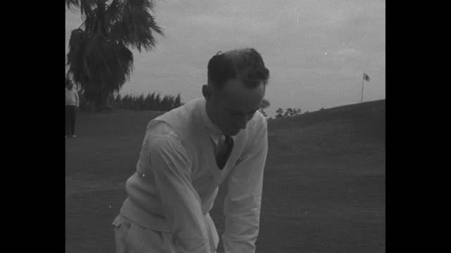 title 'florida' superimposed with golfer denny shute / he drives balls to african-american caddies holding balloons over a sand trap / shute / the... - drive ball sports stock videos & royalty-free footage