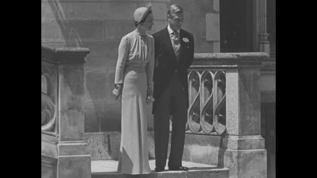 france superimposed over the duke and duchess of windsor exiting the chateau de cande in france after their wedding in june 1937 / duke and duchess... - wallis simpson stock videos & royalty-free footage